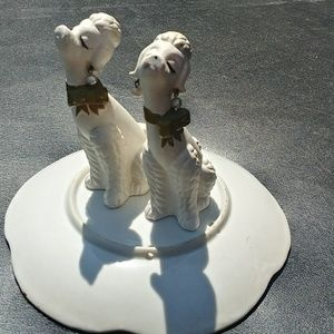 2 MCM kitschy poodles with pearl earrings